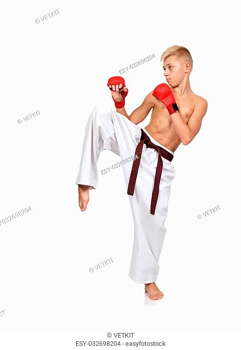 boy with red gloves training karate isolated on white background