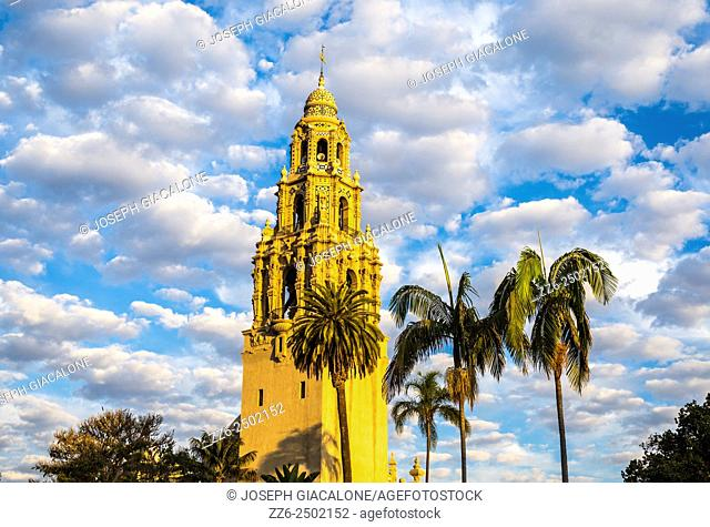 The California Tower illuminated by the rising Sun on a cloudy morning. Balboa Park, San Diego, California, United States