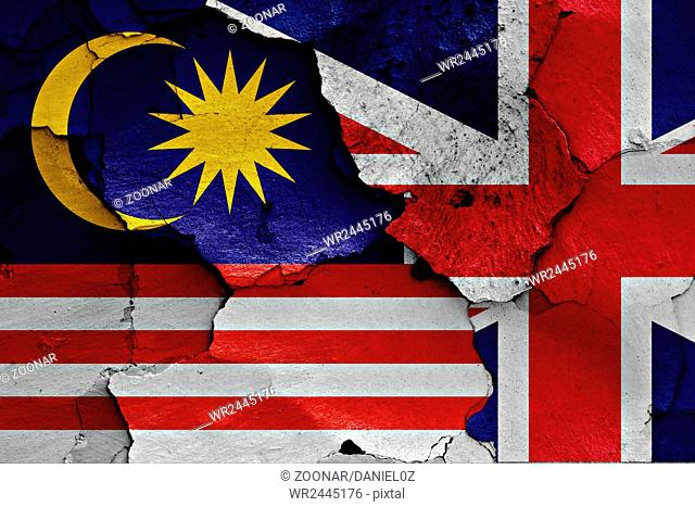 flags of Malaysia and UK painted on cracked wall