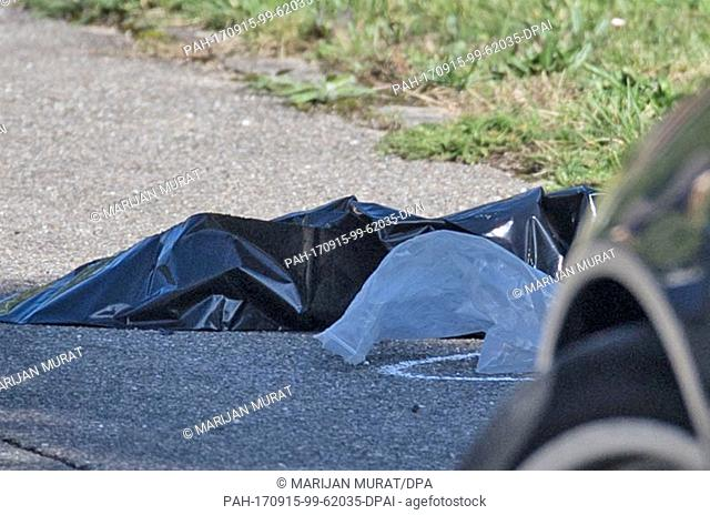 Plastic covers on a sidewalk near the crime scene in Villingendorf, Germany, 15 September 2017. A man, a woman and a 6-year-old boy have been shot dead in a...