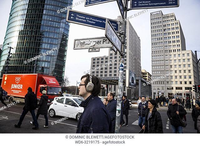A busy street scene and pedestrian crossing at Potsdamer Platz in Berlin, Germany