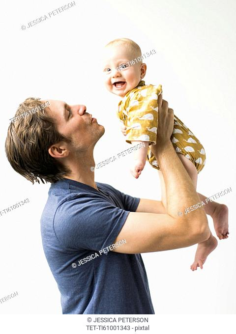 Studio portrait of father with baby son (2-5 months)