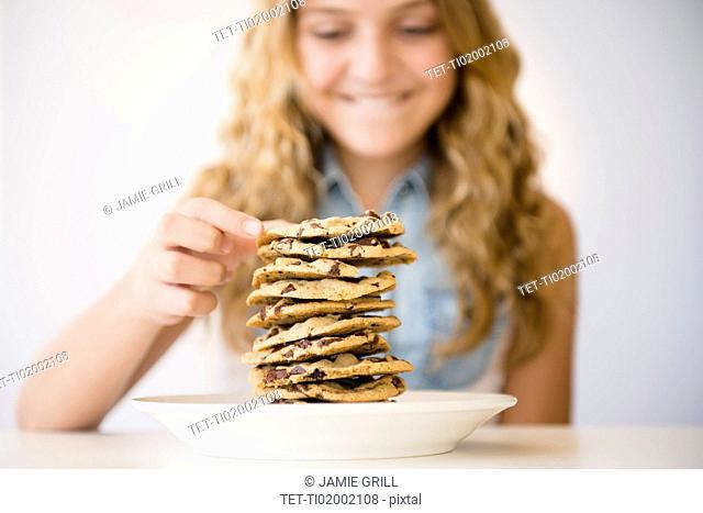 Studio shot of girl (12-13) with pancakes
