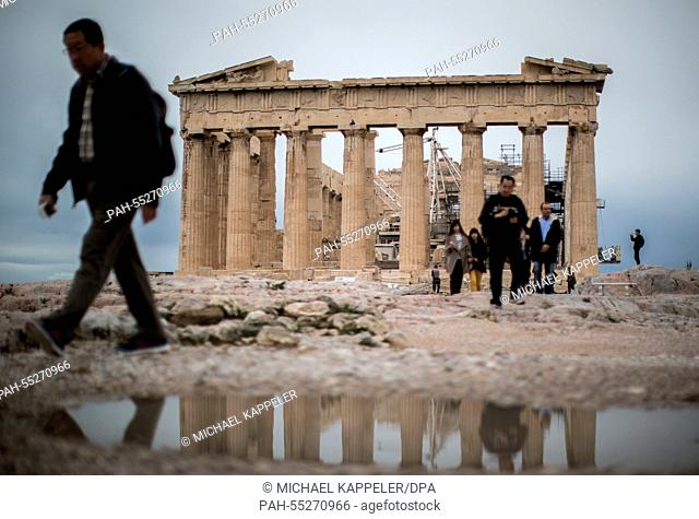 Tourists visit the Acropolis in Athens, 24 January 2015. Greece's leftist, anti-austerity Syriza party and her leader Alexis Tsipras