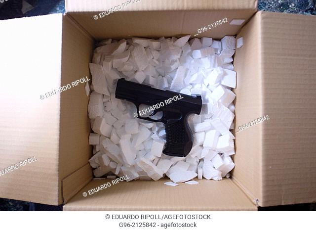 Box with handgun