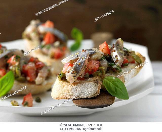 Soused herring and tomato salad on fresh baguette