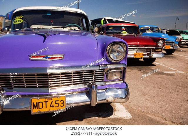 Vintage American cars used as taxis at the parking lot near the Malecon, Havana, La Habana, Cuba, Central America
