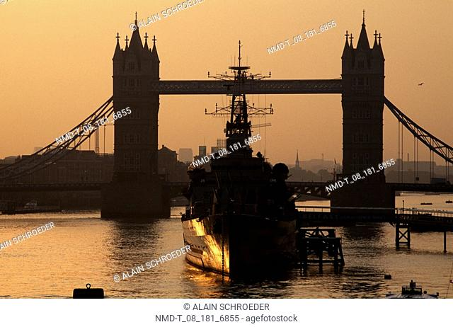 Silhouette of a bridge across a river, Tower Bridge, London, England
