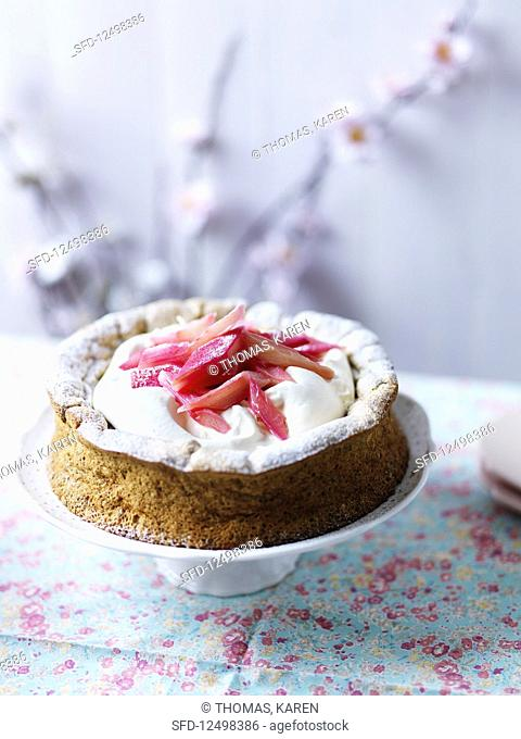 Pistachio and raspberry cake with meringue, whipped cream, icing sugar