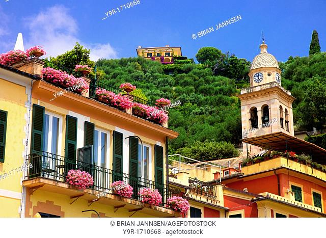 Flower boxes and building details Portofino with the church tower of San Martino, Liguria Italy