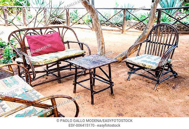 Kenya. Elegant furniture made of wood in an African garden