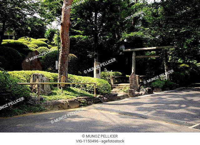 JAPAN, TOKYO, 01.07.2008, Stone Torii and japanese style garden at Buddhist Gokoku-ji Temple. Bunkyo. Tokyo. Japan - Tokyo, Tokyo, JAPAN, 01/07/2008