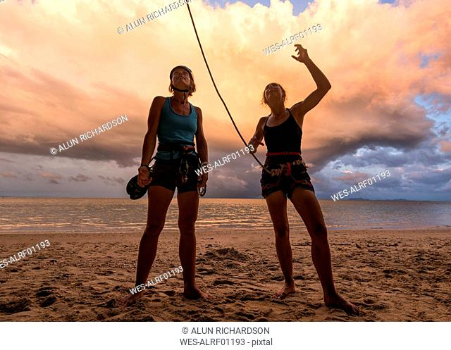 Thailand, Krabi, Lao Liang island, two female climbers discussing on the beach