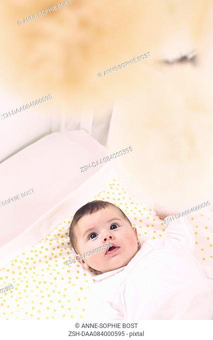 Baby lying in crib