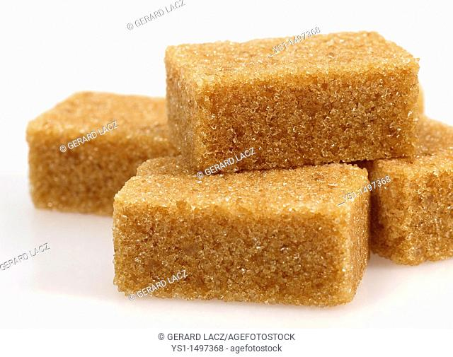 Cubes of Brown Sugar against White Background