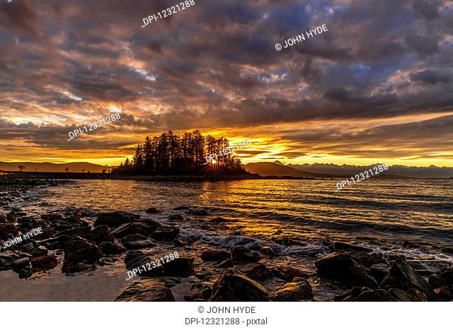 Sunset along the Inside Passage near Juneau, Favorite Passage, Chilkat Mountains in the distance; Alaska, United States of America