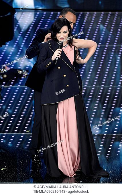 Carlo Conti and Laura Pausini with the jacket which won the festival during the 66th Sanremo Festival, Sanremo, Italy 09/02/2016