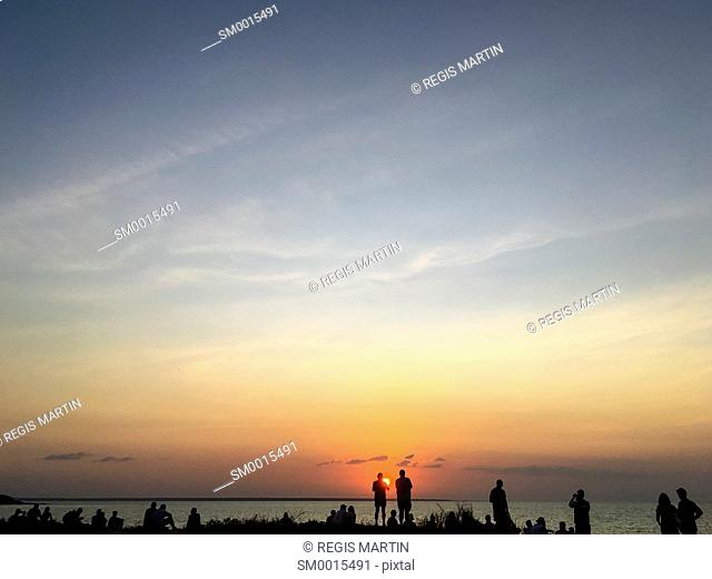 Silhouette of people watching the sunset at Mindil Beach, in Darwin, Northern Territory, Australia