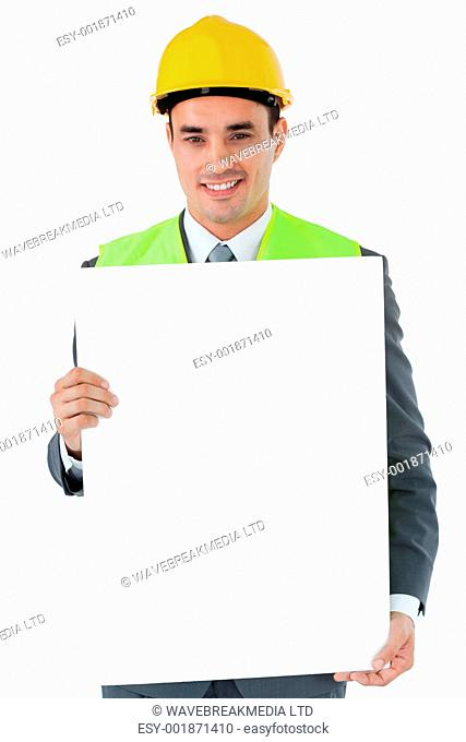 Smiling architect holding sign against a white background