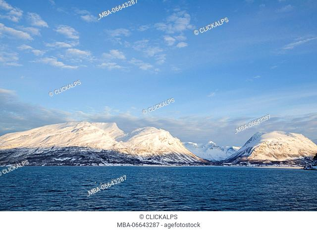 Blue sky on the snowy peaks surrounded by frozen sea Olderdalen Kafjorden Lyngen Alps Tromsø Norway Europe