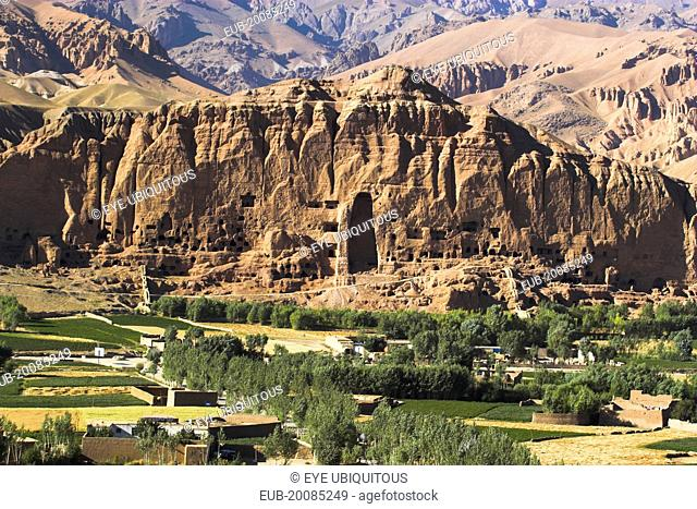 View of Bamiyan valley and village showing cliffs with empty niche where the famous carved Budda once stood (destroyed by the Taliban in 2001)