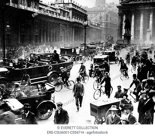 English General Strike. Londoners, in front of the Bank of England, getting to work by car, bicycle, and foot. May 4-13, 1926
