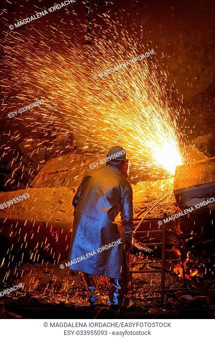 welder cut metal in steel plant