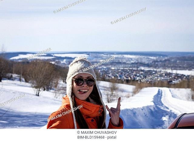 Caucasian woman gesturing on snowy road