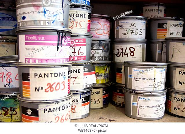 Paint cans stacked on shelf