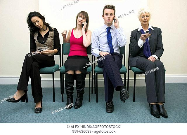 Diverse group of business people using mobile phones