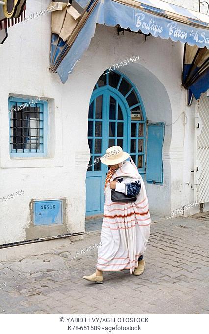 Woman wearing traditional veil (hijab), Djerba, Tunisia
