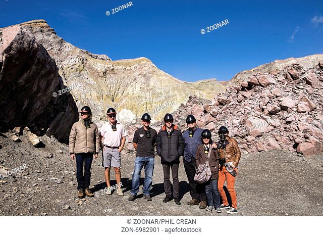 Visitors to White island volcano with James Buttle, one of the family who own the island 5th from right, off the coast of New Zealand