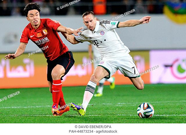 Franck Ribery (R) of Bayern Munich and Xuri Zhao of Guangzhou vie for the ball during the FIFA Club World Cup semi final soccer match between Guangzhou...