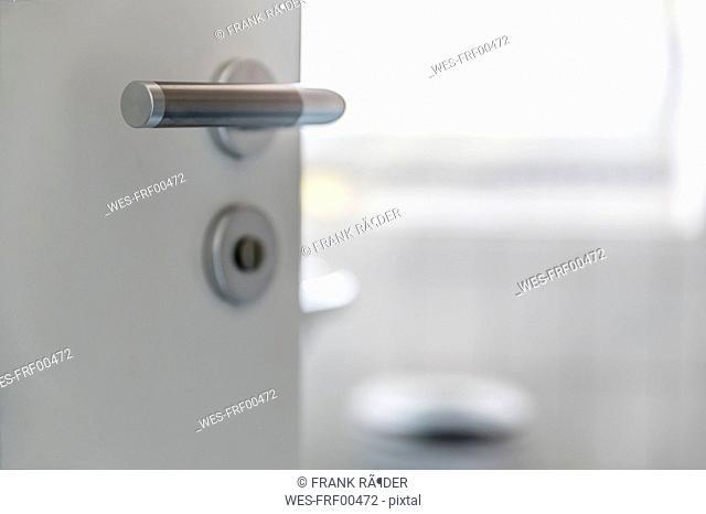 Doorknob of open bathroom door
