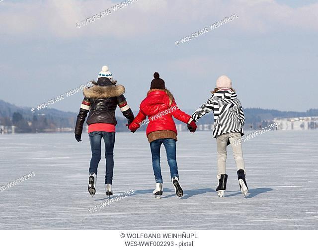 Austria, Teenage girls doing ice skating