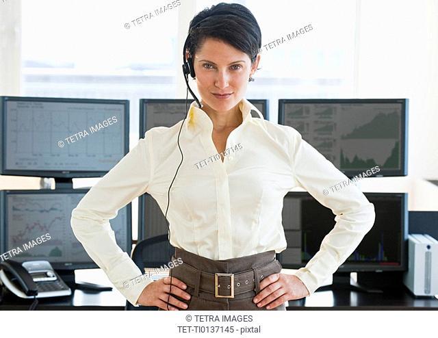 Female trader looking at camera