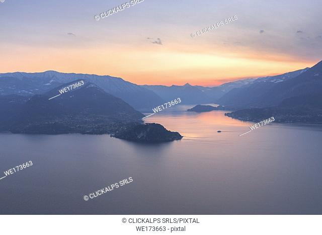 A boat is going to reach the village of Bellagio at sunset. Como Lake, Lombardy, Italy, Europe