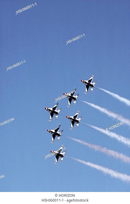 Low angle view of USAF thunderbirds team F-16s squadron in delta formation