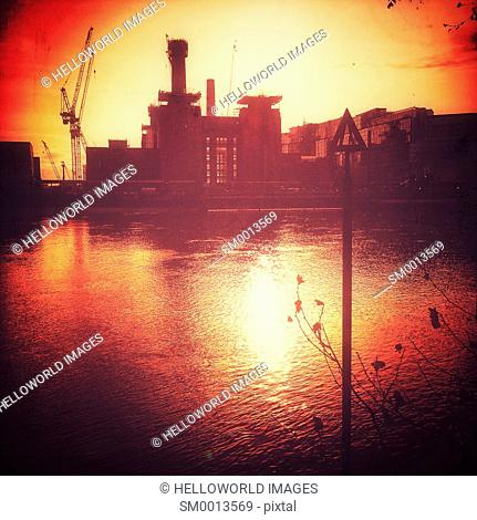 Battersea Power Station development and water level marker at sunset, London, England