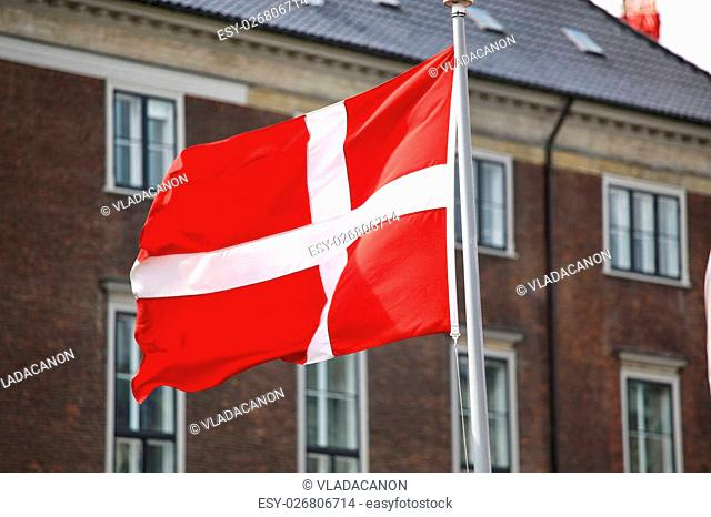 Waving Danish flag on the mast in Copenhagen, Denmark