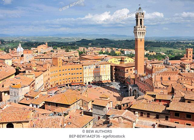 City view of Siena, Tuscany, Italy, with bell tower and square: Torre del Mangia and Piazza del Campo