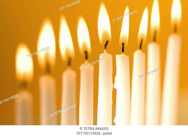 Candles burning in a menorah