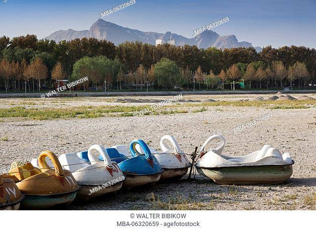 Iran, Central Iran, Esfahan, swan boats on dried out riverbed of the Zayandeh River