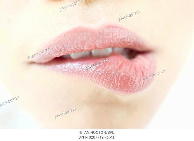 Woman biting lip