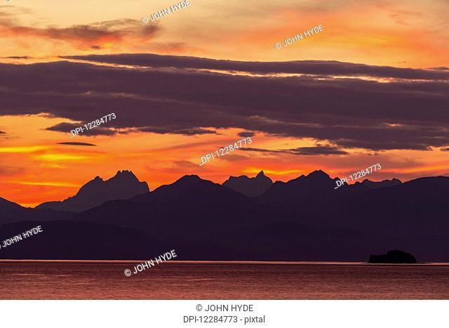 Sunset along the Inside Passage near Juneau, Favorite Passage, Chilkat Mountains; Alaska, United States of America