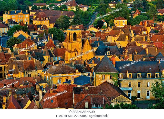 France, Dordogne, Dordogne Valley, Black Perigord, Sarlat la Caneda, horizontal view of a cityscape representing the historic city center of Sarlat at sunset