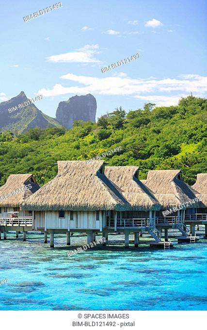 Bungalows over tropical ocean, Bora Bora, French Polynesia