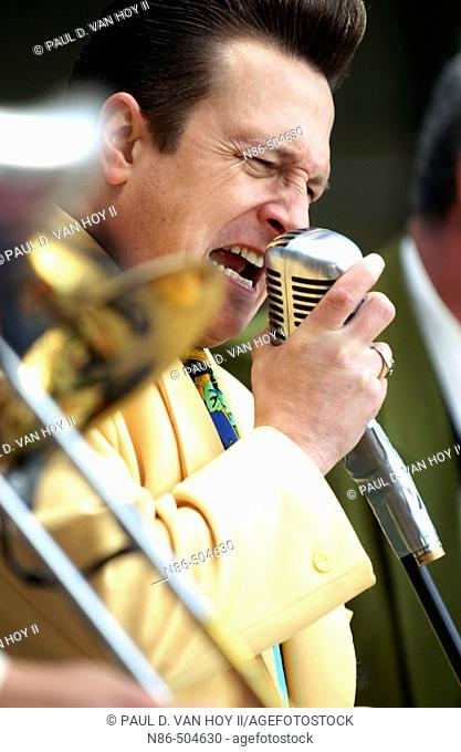Old time swing band singer singing into microphone