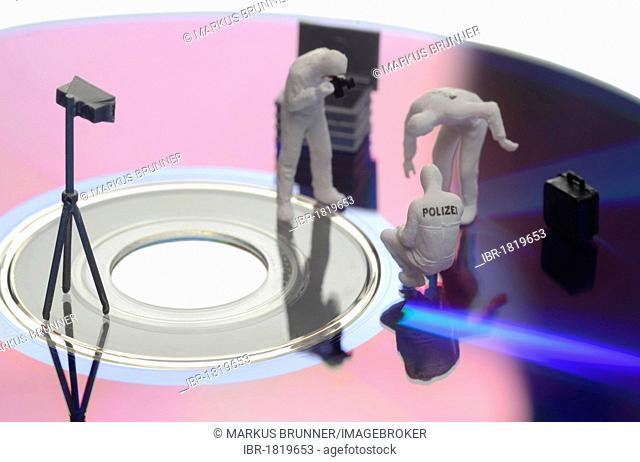 Forensics, figurines, data CD, symbolic image for data theft, piracy