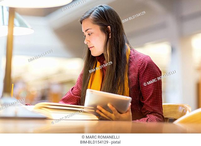 Mixed race student studying in library